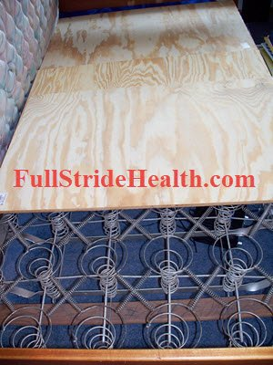 That Old Bed with 3 pieces of plywood for the DIY latex mattress. FullStrideHealth.com