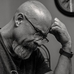 Man trying to think. Could it be Alzheimer's ? FullStrideHealth.com