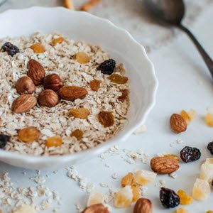 Vegetarian keto diet. Bowl of oatmeal, nuts and fruit. FullStrideHealth.com