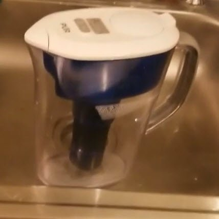 Pur water pitcher in a stainless steel sink. FullStrideHealth.com
